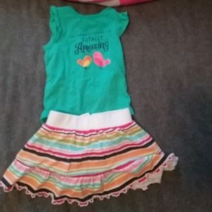 Cute baby onsie and striped skirt size 3 months